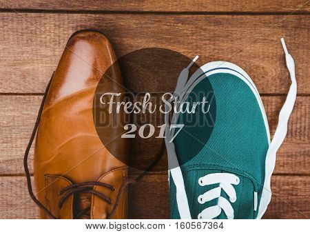 2017 new year wishes with formal and casual shoes on wooden background