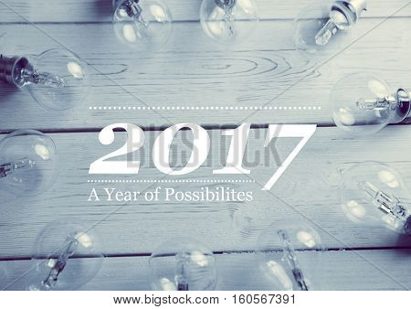 2017 new year wishes with electric bulbs on wooden background