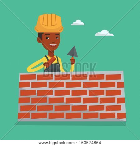 Bricklayer in uniform and hard hat. An african-american bicklayer working with spatula and brick on construction site. Bricklayer building brick wall. Vector flat design illustration. Square layout.
