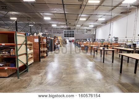 Interior Of Factory With Empty Work Benches