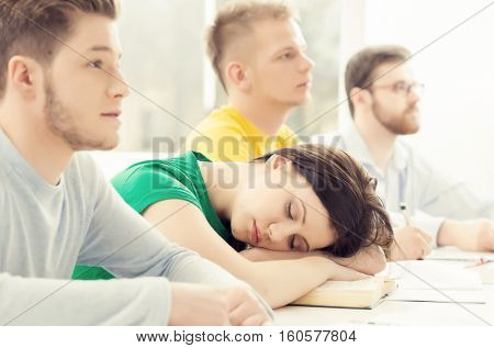 Student sleeping on a lesson. Tired and depressed girl.