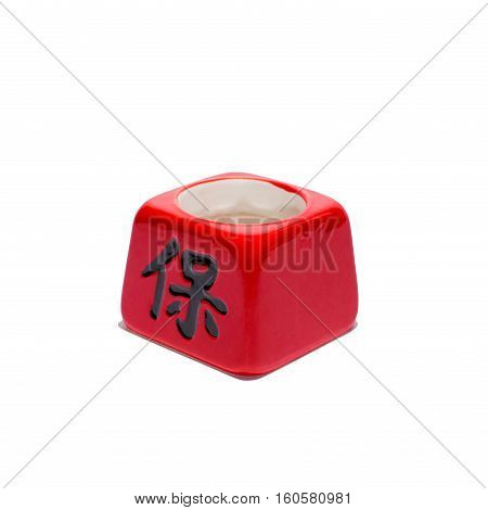 Chinese red cup with black hieroglyph isolated, white background