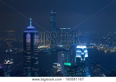 Night high Center tower with illumination and river in Hong Kong, China, view from Queen Garden