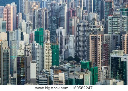 Modern tall residential buildings in sleeping area in Hong Kong, China, view from China Merchants Tower