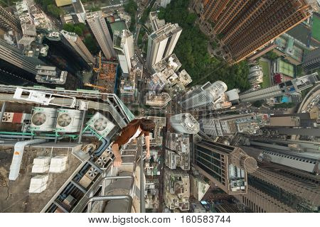 High skyscrapers, buildings roofs and roofer in Hong Kong city, China, aerial view from Manulife Plaza