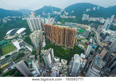 High skyscrapers, office buildings and green mountains in Hong Kong city, China, aerial view from Manulife Plaza