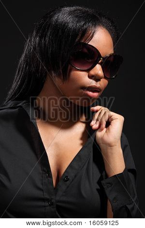 Beautiful Black Woman In Dark Sunglasses And Shirt