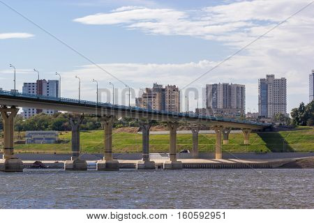 Urban view of the background of the bridge over the river
