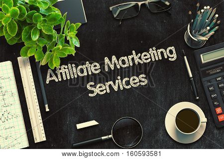 Top View of Office Desk with Stationery and Black Chalkboard with Business Concept - Affiliate Marketing Services. 3d Rendering. Toned Illustration.