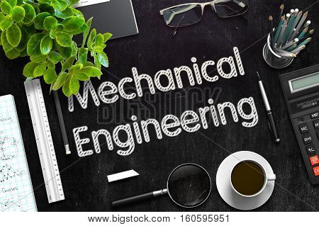 Business Concept - Mechanical Engineering Handwritten on Black Chalkboard. Top View Composition with Chalkboard and Office Supplies on Office Desk. 3d Rendering. Toned Image.