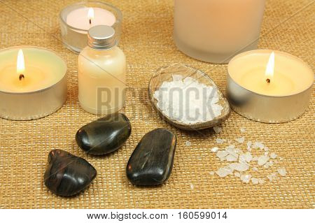 Spa composition with candles, salt and pebbles