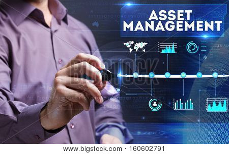 Technology, Internet, Business And Marketing. Young Business Person Sees The Word: Asset Management