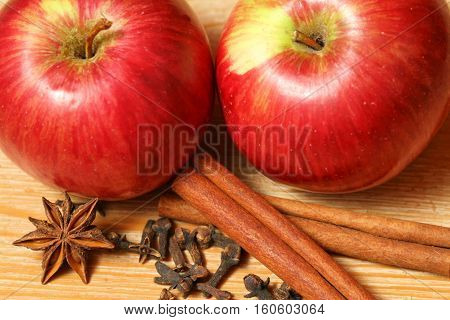 Apples and spices - two juicy fruits with cinnamon cloves and star anise