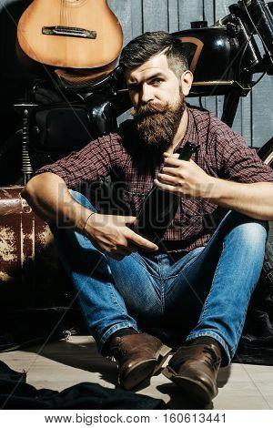 Bearded Biker Man With Bottle