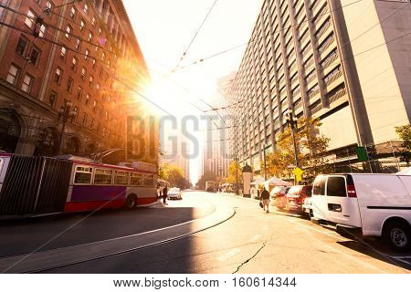 road in midtown of san francisco with sunbeam