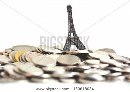 saving money for travel Paris , falling money box with white background,blued background