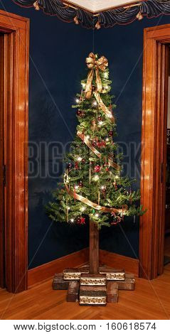 Rustic Victorian Alpine Christmas Tree in Corner