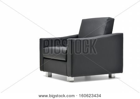 Office armchair in black leather isolated on white background