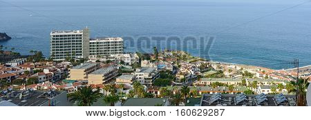 LOS GIGANTES, SPAIN - OCTOBER 05: Morning tropical sun is illuminating the ocean coast on October 05, 2014 in Los Gigantes on Tenerife Island, Canary Islands, Spain.