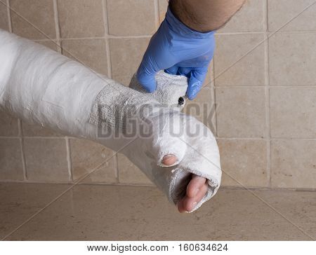 Orthopedic Technician Putting On A Fiberglass  Plaster Cast