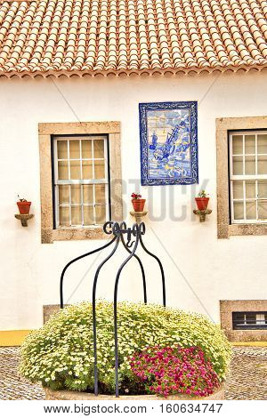 Seaside cottage in Cascais, Portugal with nautical ceramic plaque.