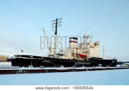 04.12.2016.Russia.Saint-Petersburg.Large nuclear-powered icebreaker moored near the shore.