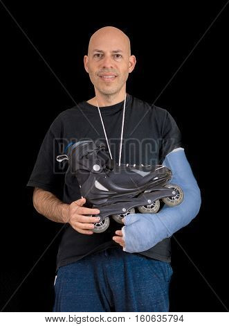 Young Man Wearing An Arm Cast After A Skating Accident