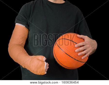 Young Man In An Arm Cast After A Basketball Accident