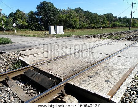Crossing the road through the double-track railway.