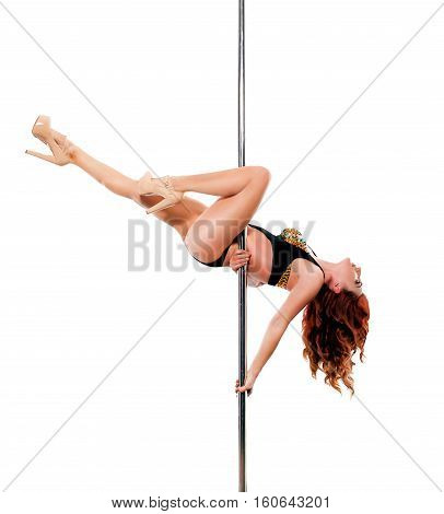 Young red hair woman in high heels shoes on pylon on white background