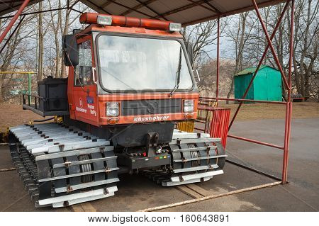 Red Service All-terrain Vehicle On Tracks