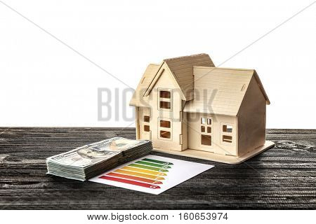 Plywood toy house with dollars on white background