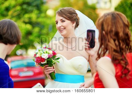 Bridesmaid Is Taking Photo Of A Bride