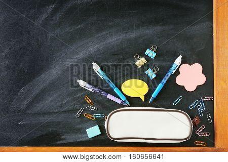 School stationery on blackboard, top view