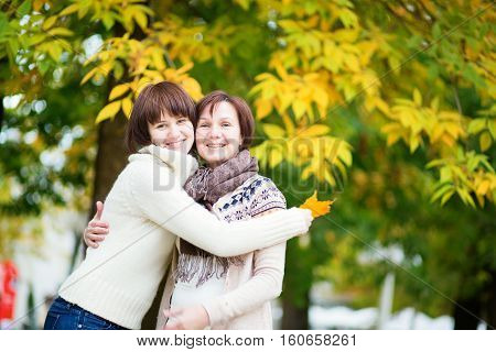 Middle Aged Woman With Daughter On A Fall Day