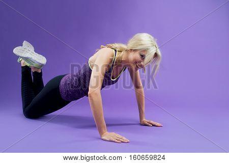 Young Woman Doing Push-Ups workout fitness, studio