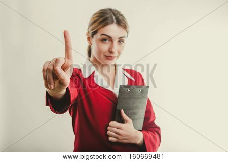 Business concept. Girl says no on light background