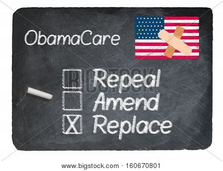 Obamacare health plan choice for replace written in chalk on a chalky natural slate blackboard isolated against white background
