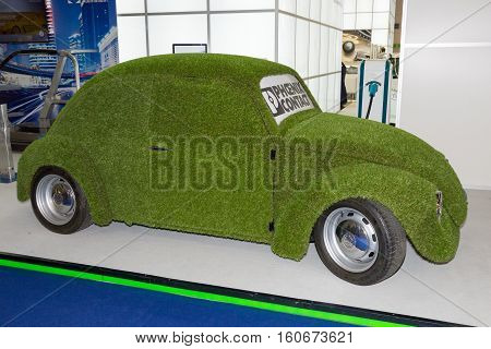 FRANKFURT GERMANY - SEP 20 2013: Grass covered Volkswagen Beatle on display at the Frankfurt IAA motor show.