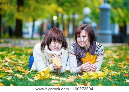 Mother And Daughter Together On A Fall Day