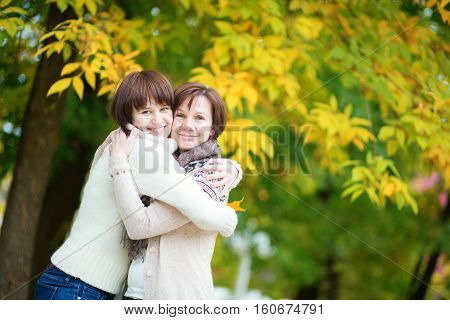 Mother And Daughter On A Bright Fall Day