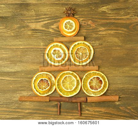 christmas tree made of cinnamon sticks and dry slices of orange