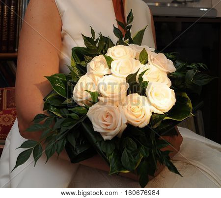 A Bride With Flowers In Her Hand