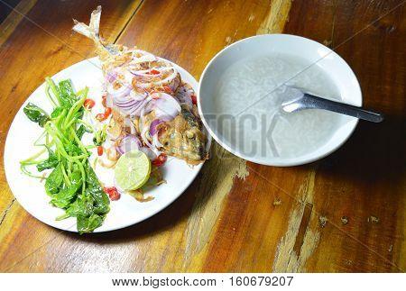 deep fried mackerel salad eat couple with rice porridge