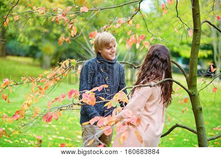 Dating Couple In Park On A Spring Or Fall Day