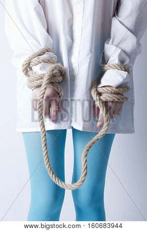 Crazy kind of young girl with hands tied with rope