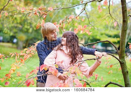 Dating Couple In Park On A Fall Day