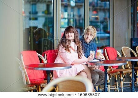 Dating Couple Drinking Coffee In A Parisian Cafe
