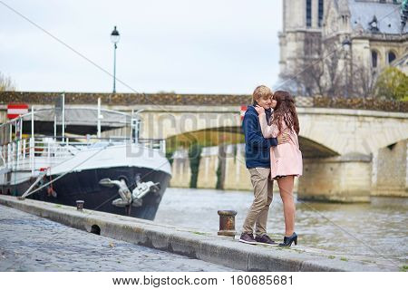 Dating Couple On The Seine Embankment In Paris