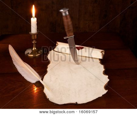 Vintage photo of a dagger cutting into an old document